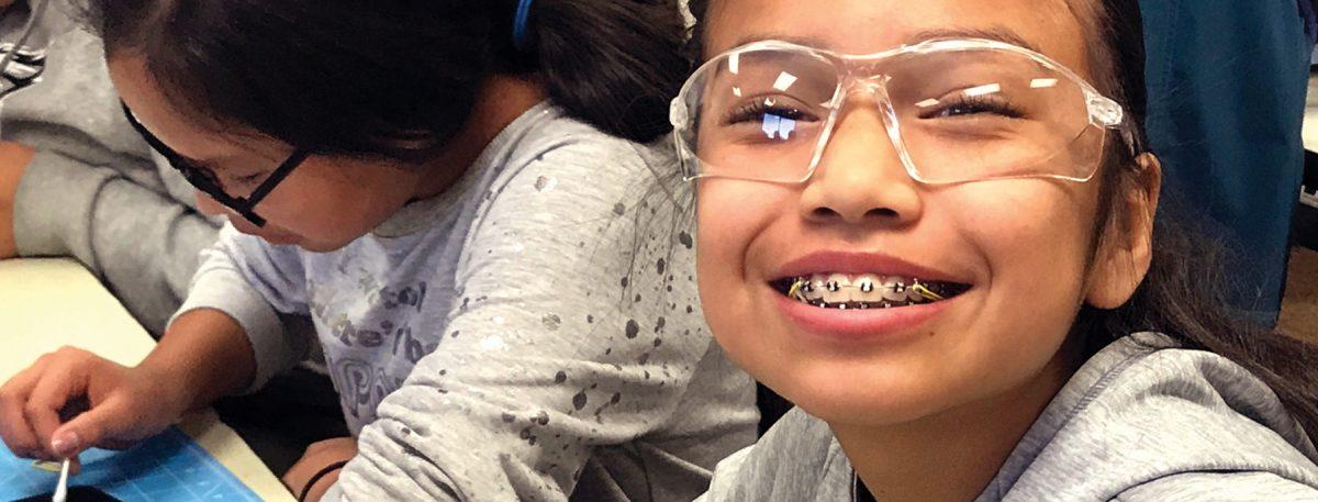 Montezuma Creek Elementary school student in fused glass workshop.